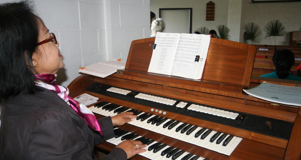 Woman playing church organ