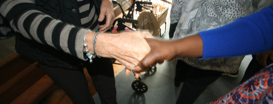 Two people shaking hands in greeting