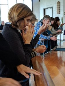 Parishioners in prayer at the altar rail