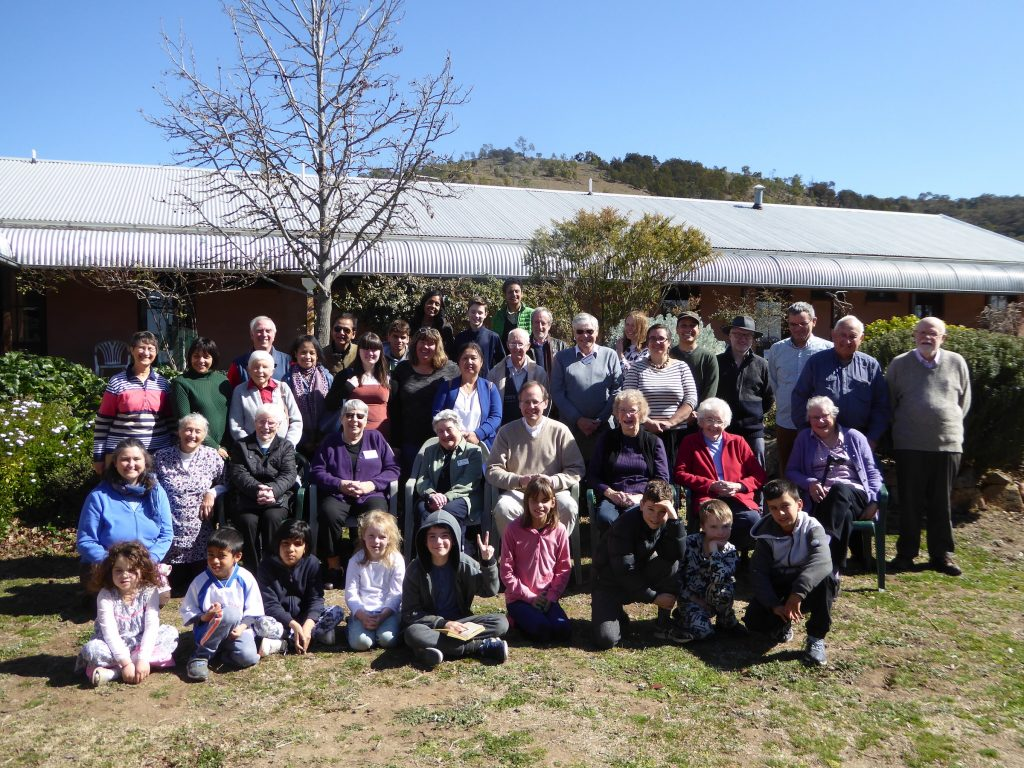 Large group gathered outside Silver Wattle Centre for group photograph