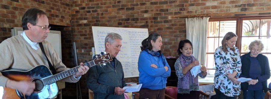 Rev Tim Watson plays guitar with people singing
