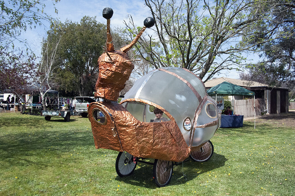 Large glass and recycled metal snail pedalled on the church lawns