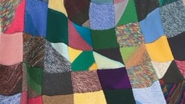 Close up of colourful patchwork blanket